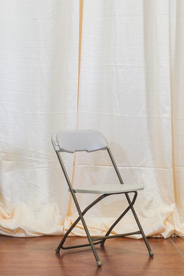 Where to find BONE PLASTIC FOLDING CHAIR in Longview
