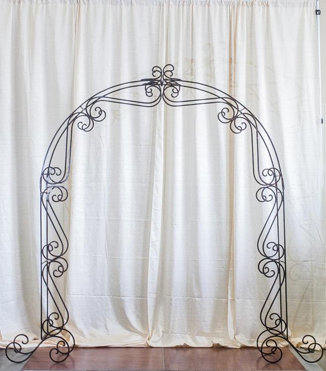 Where to find ORNATE WROUGHT IRON ARCH in Longview